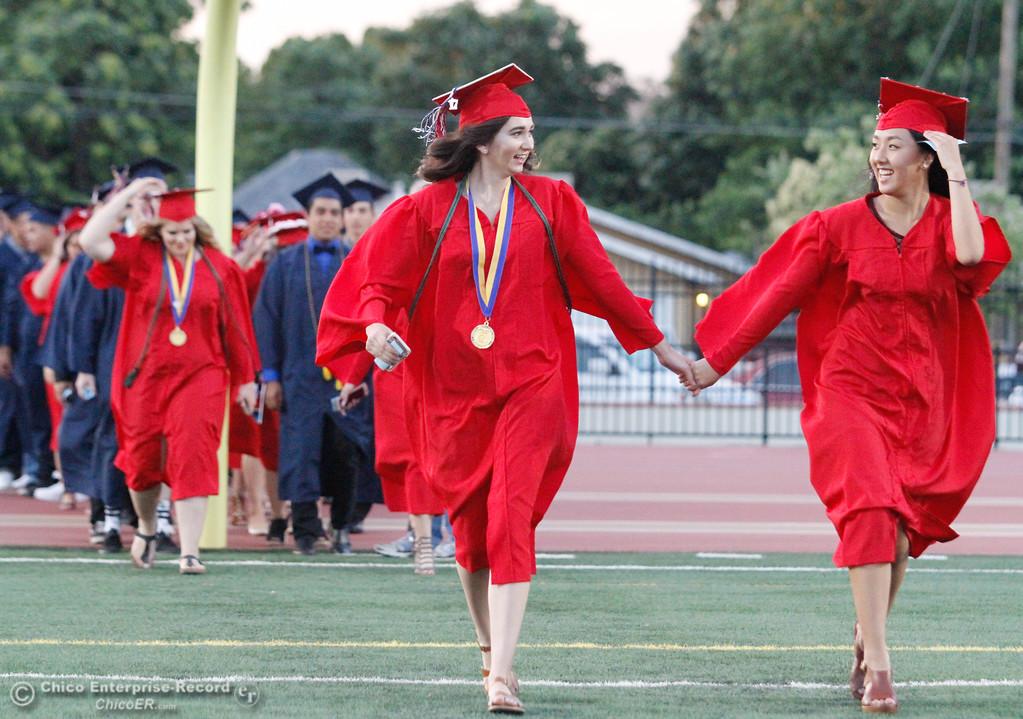 . Hand in hand excited Las Plumas High School students enter their graduation ceremony Friday June 9, 2017 at Harrison Stadium in Oroville, California. (Emily Bertolino -- Mercury Register