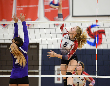 Las Plumas's Lilly Wentz spikes the ball for a kill over Oroville's defense Thursday September 28, 2017 at in Oroville, California. (Emily Bertolino -- Mercury-Register)