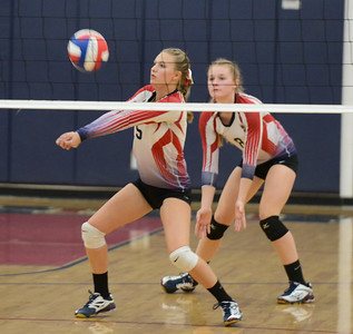 Las Plumas' Becca Graham pumps the ball with teammate Lilly Wentz providing backup during a volleyball game against Oroville High Thursday September 28, 2017 at in Oroville, California. (Emily Bertolino -- Mercury-Register)