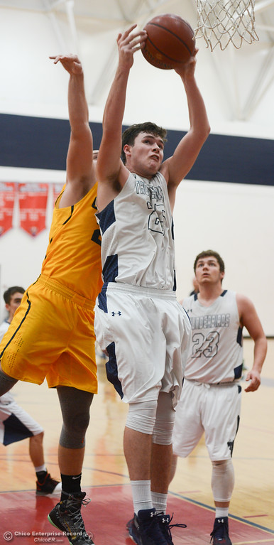 . Gridley\'s Tyler Little (24) attempts to block Las Plumas\' Sullivan Hurte (25) as he goes up for a shot, Friday, February 2, 2018, in Oroville, California. (Carin Dorghalli -- Enterprise-Record)