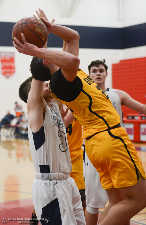. Gridley\'s Brian Wilkerson (20) goes up for a shot while Las Plumas\' Michael Alexander(33) tries to block him, Friday, February 2, 2018, in Oroville, California. (Carin Dorghalli -- Enterprise-Record)