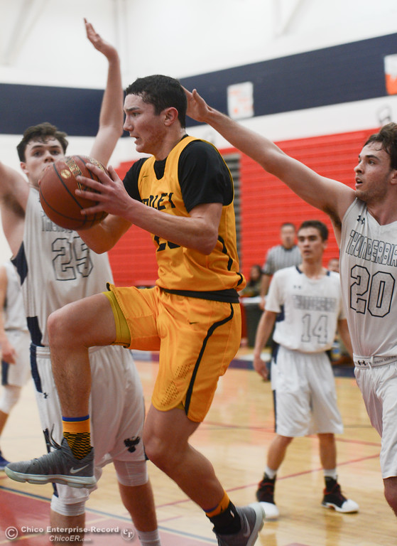 . Gridley\'s Brian Wilkerson (20) goes up for a shot as Las Plumas\' Chad Auletta (20) Sullivan Hurte (25) try to block him, Friday, February 2, 2018, in Oroville, California. (Carin Dorghalli -- Enterprise-Record)