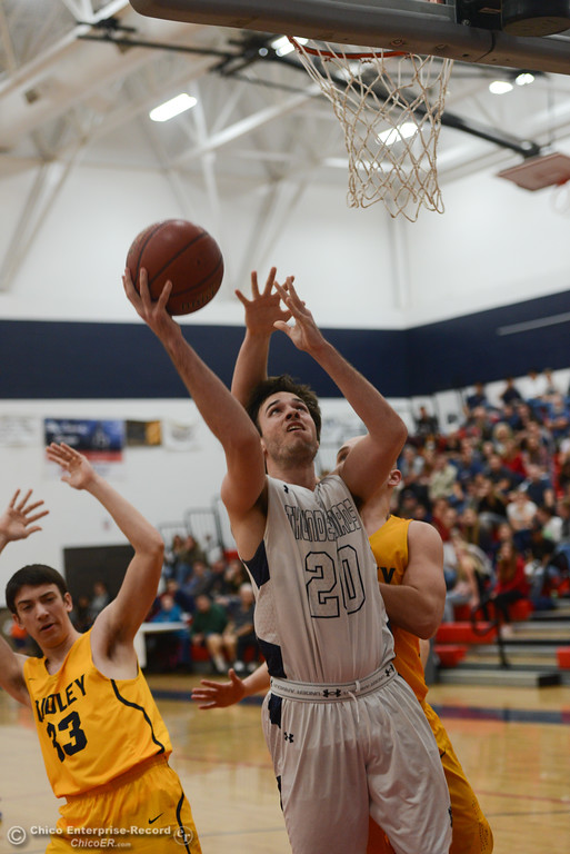 . Las Plumas\' Chad Auletta (20) makes it past Gridley\'s Emedel Guerrero (13) and Tyler Little (24) to the basket, Friday, February 2, 2018, in Oroville, California. (Carin Dorghalli -- Enterprise-Record)