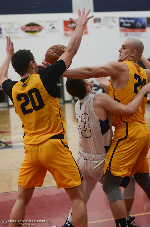 . Gridley\'s Tyler Little (24), Brian Wilkerson (20) and Las Plumas\' Michael Alexander (33) fight for the ball, Friday, February 2, 2018, in Oroville, California. (Carin Dorghalli -- Enterprise-Record)