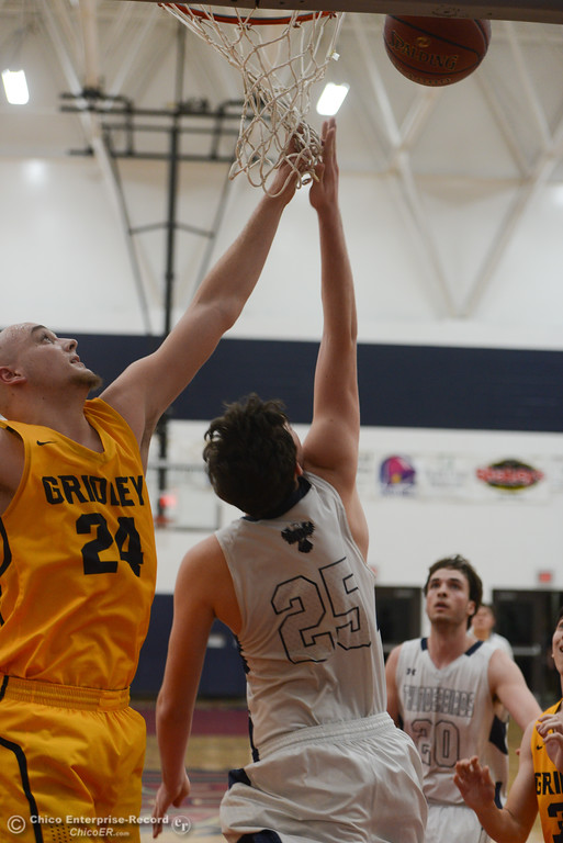 . Gridley\'s Tyler Little (24) tries to block Las Plumas\' Sullivan Hurte (25) as he goes up for a basket, Friday, February 2, 2018, in Oroville, California. (Carin Dorghalli -- Enterprise-Record)