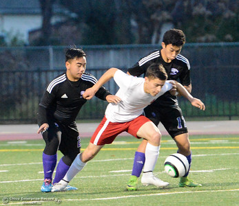 Las Plumas' Esteban Farias holds back Oroville High's Kenny Moua (2) and Leon Yang (17) during a soccer game Tuesday January 16, 2018 at Harrison Stadium in Oroville, California. (Emily Bertolino -- Enterprise-Record)