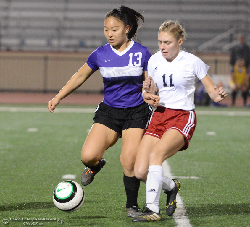 . Oroville High\'s Vang Linda (13)  and Las Plumas\' Kaitlin Morgado (11) work to gain possession Tuesday January 16, 2018 at Harrison Stadium in Oroville, California. (Emily Bertolino -- Enterprise-Record)