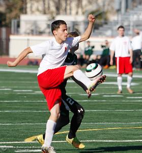 Las Plumas's Esteban Farias reaches up to kick the ball away from Paradise's defense during a soccer game January 30, 2017 in Oroville, California. (Emily Bertolino -- Enterprise-Record)