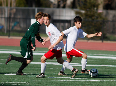 Las Plumas's Parker Paul (12) winds around as his teammate Vitor Marquez breaks away with the ball as Paradise's Rory Cone tries to keep up during a soccer game January 30, 2017 in Oroville, California. (Emily Bertolino -- Enterprise-Record)