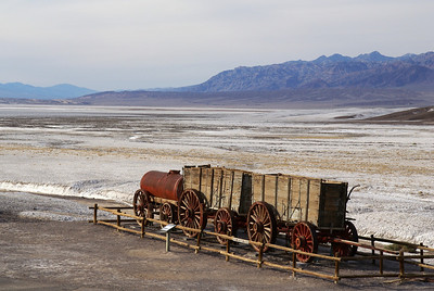 """Wagons used in the infamous """"Twenty Mule Teams"""" to haul the borax to the closet railroad which was 165 miles across the desert.  The teams pulled loads up to 36 tons and 1,200 gallons of drinking water."""
