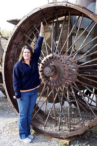 Model Michelle providing a sense of scale on how large the wheels are on the tractor.