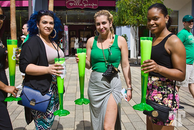 Young women with green drinks at  Linq Promenade on St.Patrick.s Day Las Vegas