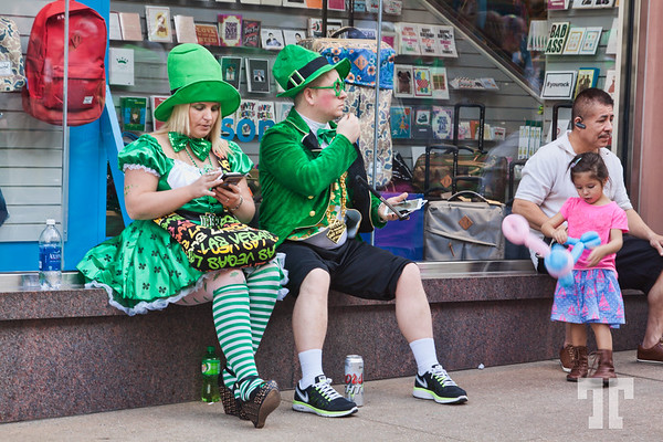 People wearing green costumes at Linq Promenade on St.Patrick.s Day Las Vegas