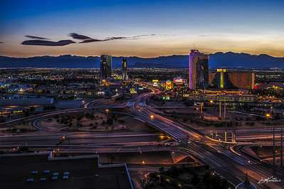Flamingo Road at I-15, with The Palms and Rio in the background.