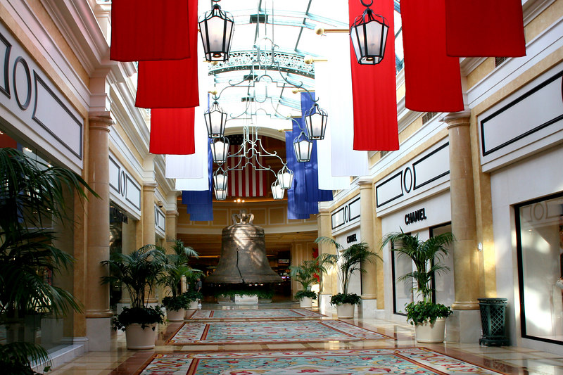 Inside Bellagio walk of shops with replica of Liberty Bell at end