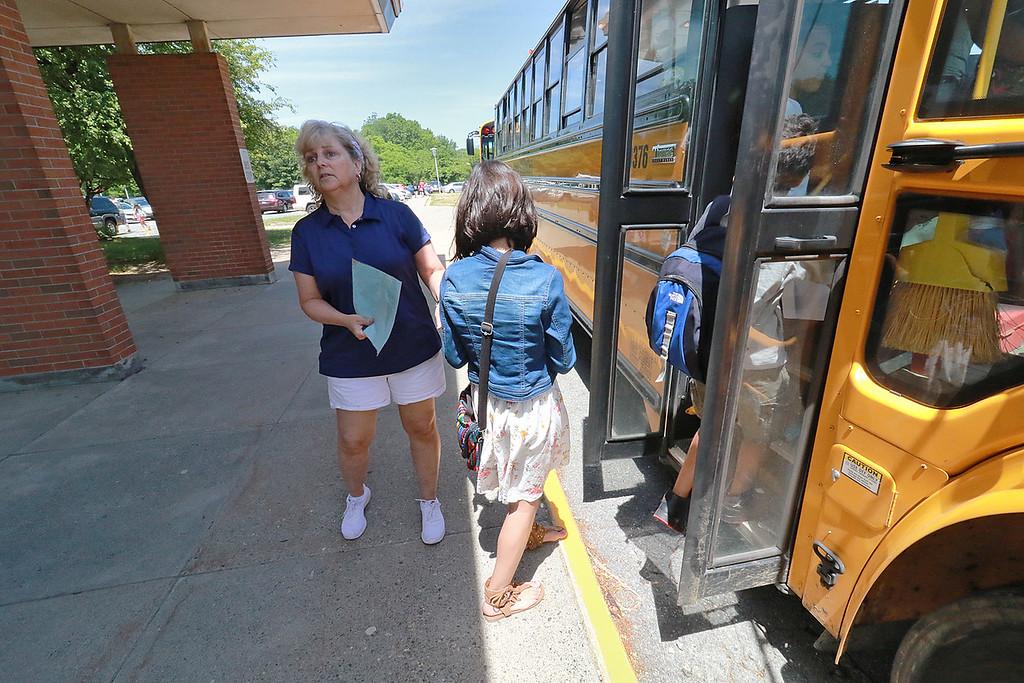 . The last day of school in Leominster was Thursday, June 22, 2018. Fall Brook Elementary School Art Teacher Paula Gravella makes sure kids get on the right busses on the last day. SENTINEL & ENTERPRISE/JOHN LOVE
