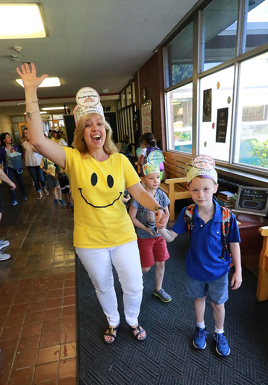 . The last day of school in Leominster was Thursday, June 22, 2018. Fall Brook Elementary kindergarten teacher Chris Conner is all smiles as she walks some of the kids out to the buses on the last day of school. SENTINEL & ENTERPRISE/JOHN LOVE