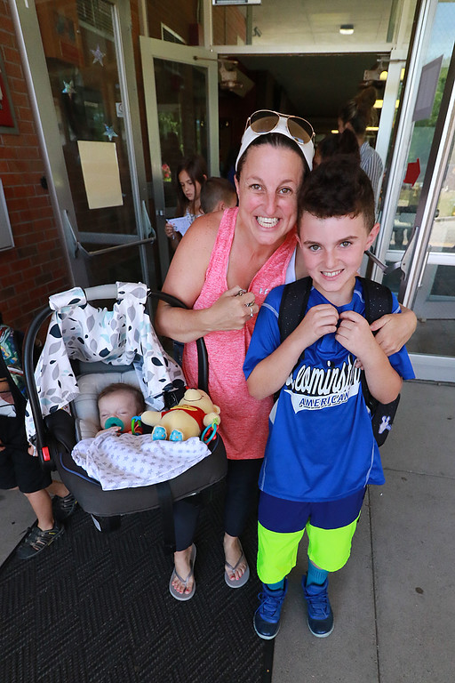 . The last day of school in Leominster was Thursday, June 22, 2018. Melissa Hendry is all smiles as he picks up her son fourth grader Sawyer Bourgeois on the last day of school at Fall Brook Elementary School. with them is her son Grayson Hendry, 2 months. SENTINEL & ENTERPRISE/JOHN LOVE