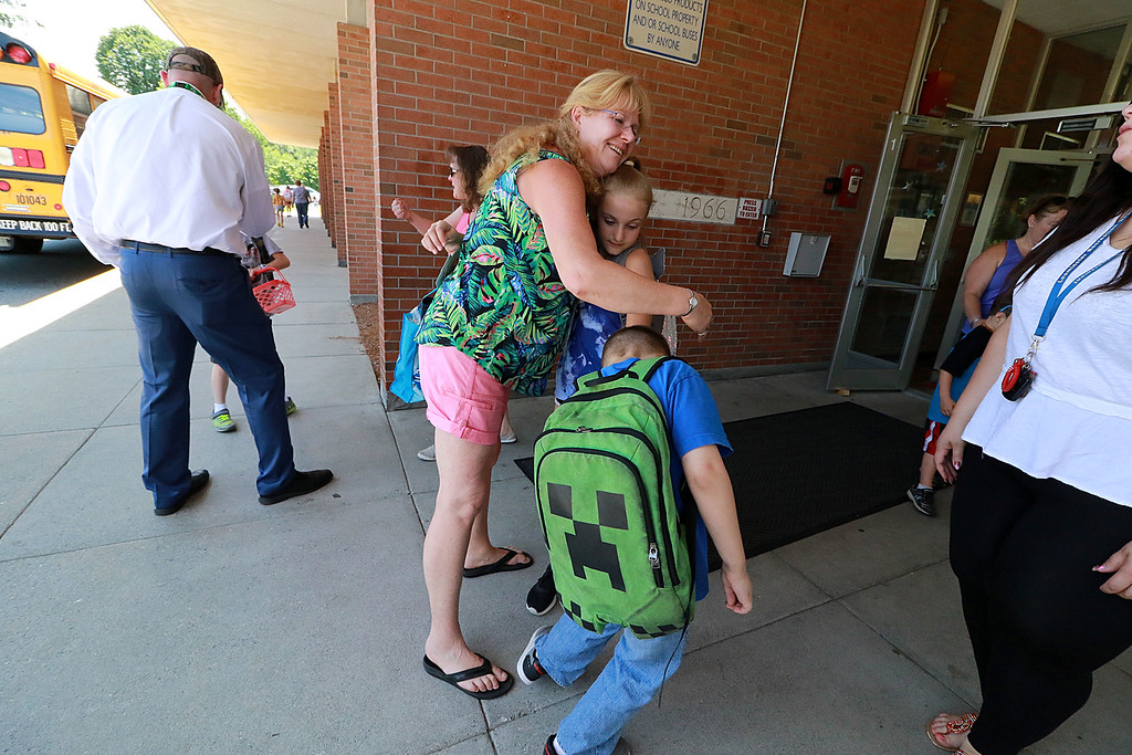 . The last day of school in Leominster was Thursday, June 22, 2018. Students hug Fall Brook Elementary School Paraprofessional Tammy Piermarini as they make their way to the busses on the last day. SENTINEL & ENTERPRISE/JOHN LOVE