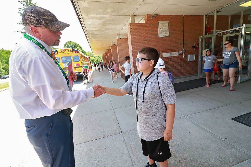 . The last day of school in Leominster was Thursday, June 22, 2018. Fall Brook Elementary School Principal Jeff Sullivan  says good by to fifth grader Eric Munoz-Areizaga on the last day of school. He will start middle school in the fall. SENTINEL & ENTERPRISE/JOHN LOVE