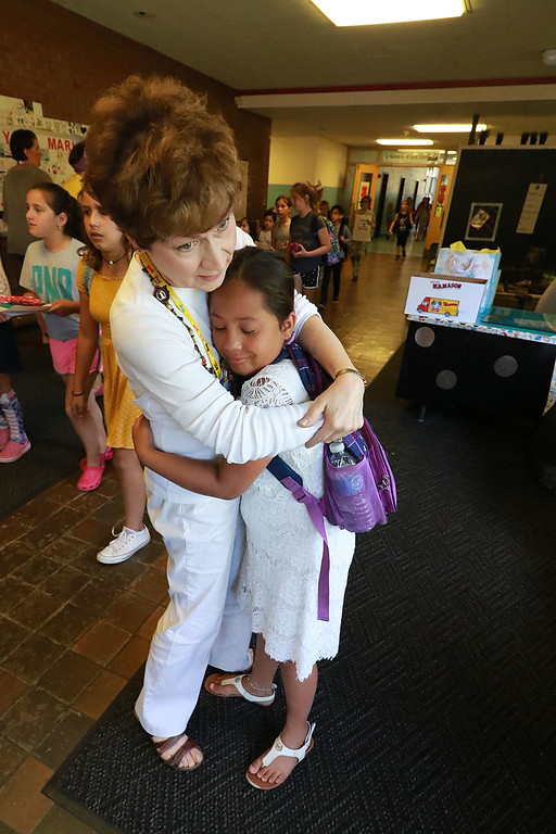 . The last day of school in Leominster was Thursday, June 22, 2018. Fall Brook Elementary School volunteer Debbie Richards got hugs from many students as they made their way to the buses on the last day. SENTINEL & ENTERPRISE/JOHN LOVE