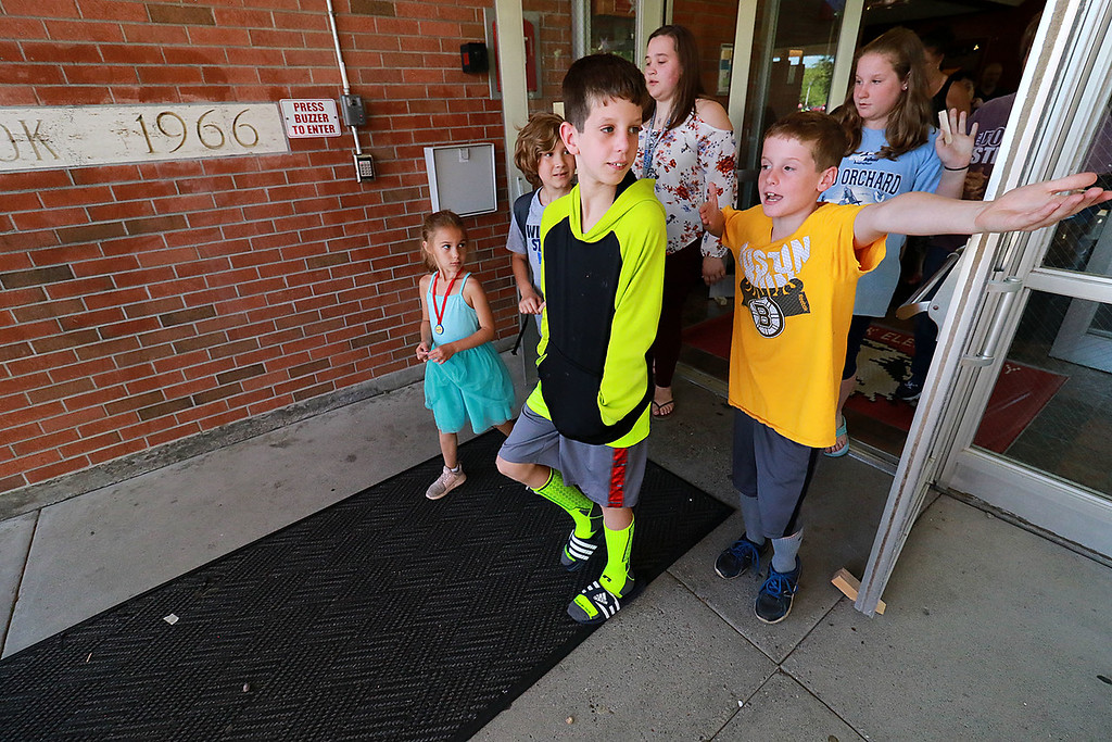 . The last day of school in Leominster was Thursday, June 22, 2018. Students being picked up by their parents at Fall Brook Elementary School leave the school on the last day. SENTINEL & ENTERPRISE/JOHN LOVE