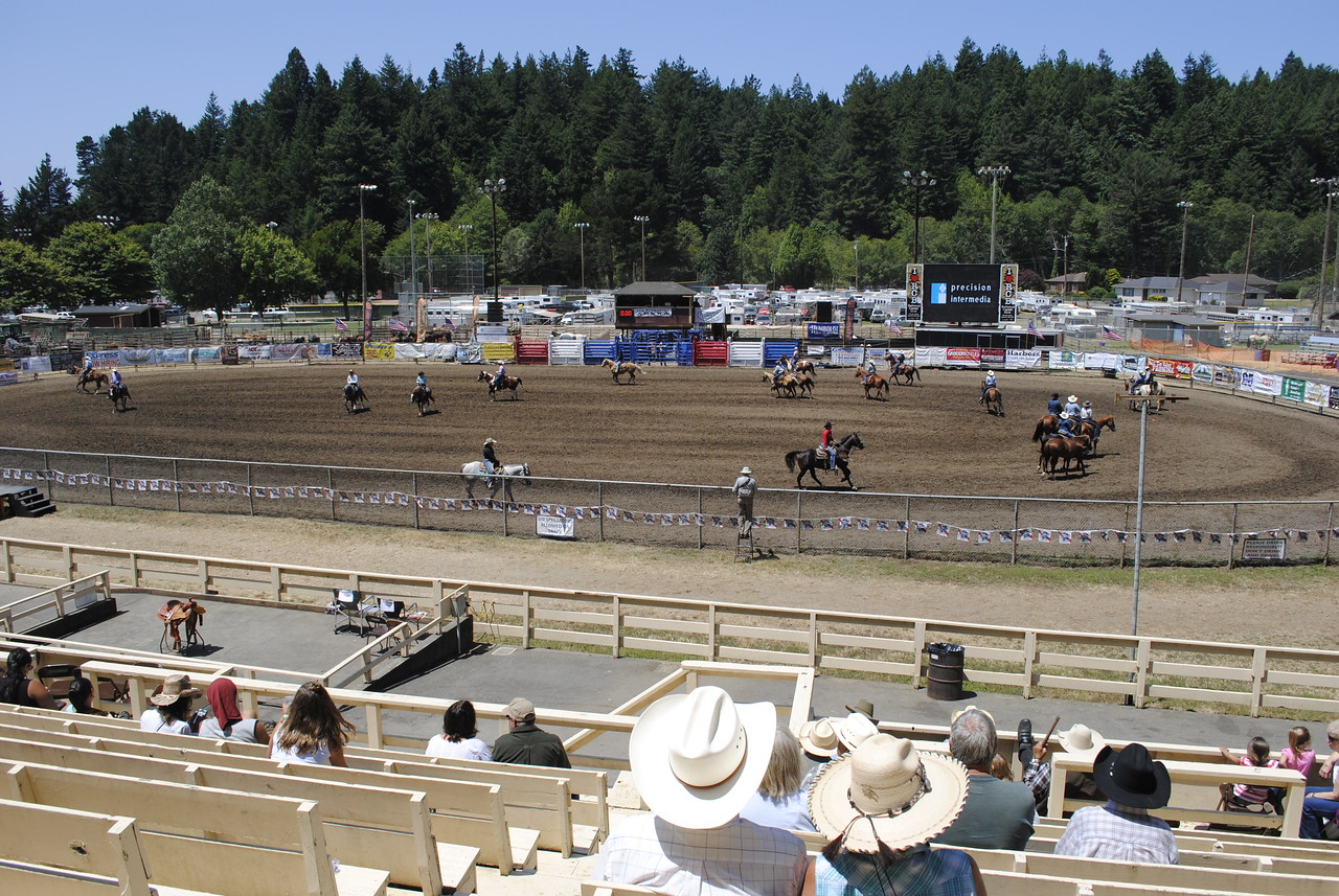 Competitors ran their horses around for a few laps ahead of the day of rodeo competition events at the Fortuna rodeo grounds on Sunday during the 96th Fortuna Rodeo. (Hunter Cresswell -- The Times-Standard)