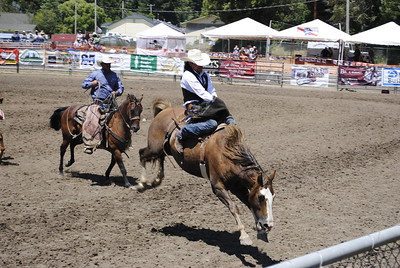 Sam Oliver of Minden, Nevada, hangs on to take second in the bareback riding event on Sunday at the Fortuna rodeo grounds during the 96th annual Fortuna Rodeo. (Hunter Cresswell -- The Times-Standard)