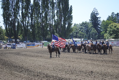 Competitors line up ahead of the singing of the National Anthem during the 96th Fortuna Rodeo on Sunday. (Hunter Cresswell -- The Times-Standard)