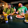 KRISTOPHER RADDER — BRATTLEBORO REFORMER<br /> Colin James takes about the COVID-19 with Richard Boucher as they enjoy a beer at Donovan's, in Bellows Falls, Vt., before the state-ordered closure of all bars and restaurants for dine-in experience at 2 p.m. Tuesday, March 17, 2020, because of the COVID-19 outbreak.