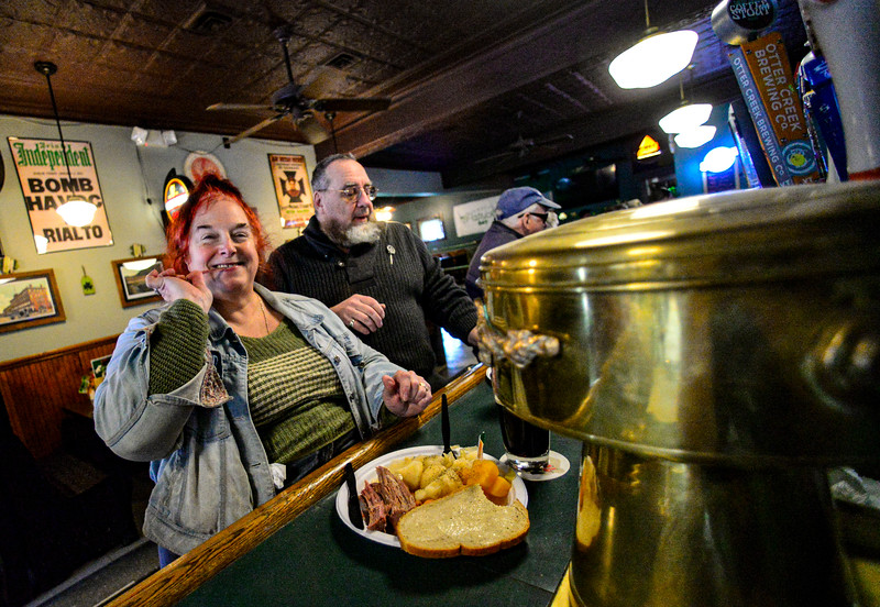 KRISTOPHER RADDER — BRATTLEBORO REFORMER<br /> Patrons get their last St. Patrick's Day drinks at Donovan's, in Bellows Falls, Vt., before the state-ordered closure of all bars and restaurants for dine-in experience at 2 p.m. Tuesday, March 17, 2020, because of the COVID-19 outbreak.