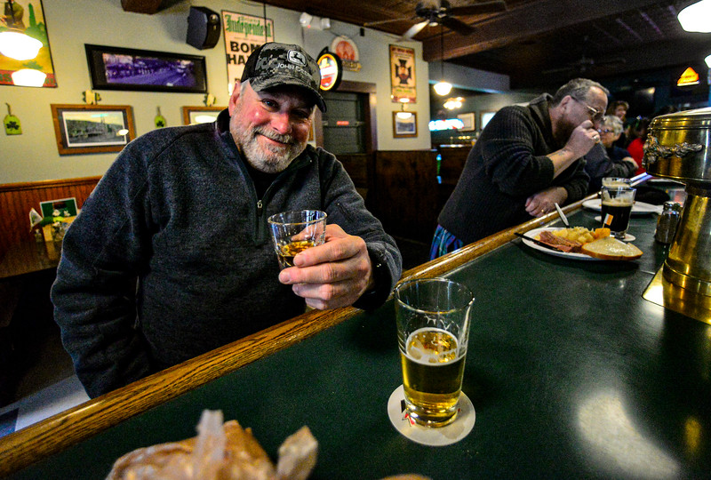 KRISTOPHER RADDER — BRATTLEBORO REFORMER<br /> Don Willson holds a shot of Disaronno at Donovan's, in Bellows Falls, Vt., before the state-ordered closure of all bars and restaurants for dine-in experience at 2 p.m. Tuesday, March 17, 2020, because of the COVID-19 outbreak.