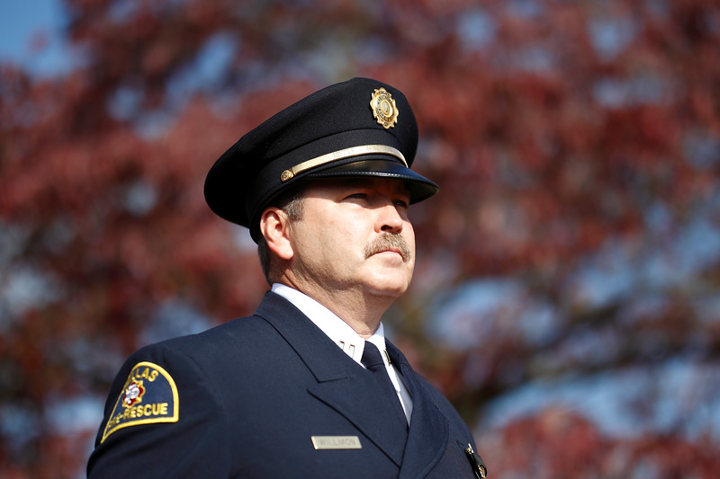 Captain Randy Willmon of the Dallas Fire Department honor guard marches in the opening processional at the 2014 National Fallen Firefighters Memorial service in Emmitsburg, Maryland.
