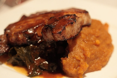 Oct. 14, 2009: I, on the other hand, had a pork chop on collard greens and sweet potato mash with gravy. The greens were very spicy!  Quite delicious.