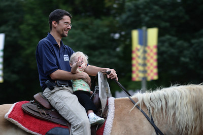 "Sept. 22, 2009: John and his little girl.  When they come by, she is constantly saying, ""I ride? I ride?""  Not even two yet!"