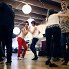 Byron Morales and Maider Lehr, center, dance together during a late night salsa dance class at Alchemy of Movement on Saturday May 7, 2016 in Boulder. (Photo by Trevor Davis)
