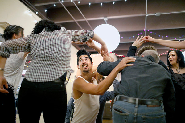 Byron Morales twirls around and under dance partners during a late night class at Alchemy of Movement on Saturday, May 7, 2016 in Boulder. (Photo by Trevor Davis)