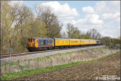 73961 brings up the rear of 1Q51 1115 Derby RTC Network Rail-Eastleigh Alstom hauled by 73965 at Rotherby on 12/04/2021. (A lineside solar panel has been digitally removed).