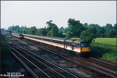 73209 approaches Gatwick Airport whilst working the 1815 London Victoria-Gatwick Airport service on 26/05/1992. 73212 'Airtour Suisse' working the 1835 Gatwick Airport-London Victoria service can be seen in the distance.