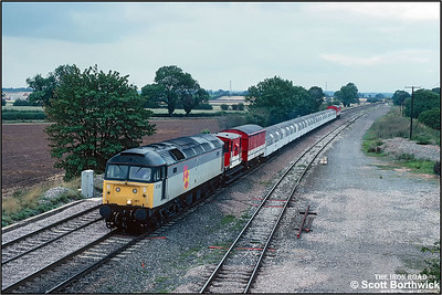 47287 passes Elford whilst working 9V30 1330 FO Derby C&W Depot-Didcot TC conveying refurbished London Underground stock on 07/09/1990.