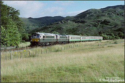 26001+26007 approach Attadale with 2H86 1705 Kyle of Lochalsh-Inverness on 25/08/1993.