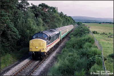 37431 approaches Muir of Ord whilst in working 2H87 1838 Inverness-Kyle of Lochalsh on 13/07/1993.