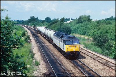 47094 passes Aristotle Lane, Oxford whilst working 7L56 1425 ThO Banbury Oil Sdgs-Ripple Lane West SS on 27/06/1991.