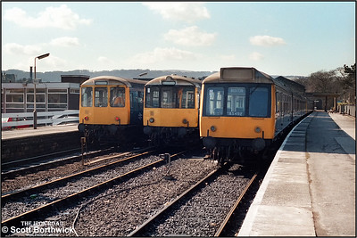 Buxton Class 108 set BX492 (52050/59389/51935) and two Class 104 sets BX483 & BX485 stand at Buxton on 19/03/1986.