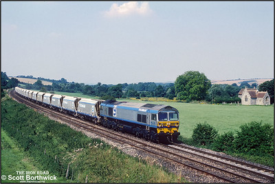 59003 'Yeoman Highlander' passes the Church of St Nicholas of Mira at Little Langford whilst working 7O37 1130 Westbury Down TC-Eastleigh East NY on 31/07/1992.