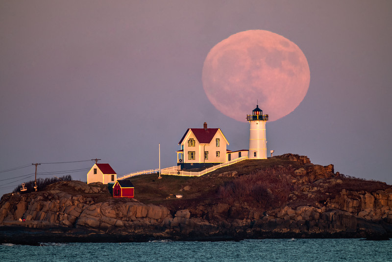 November Moon rising over Nubble Lighthouse in Maine.
