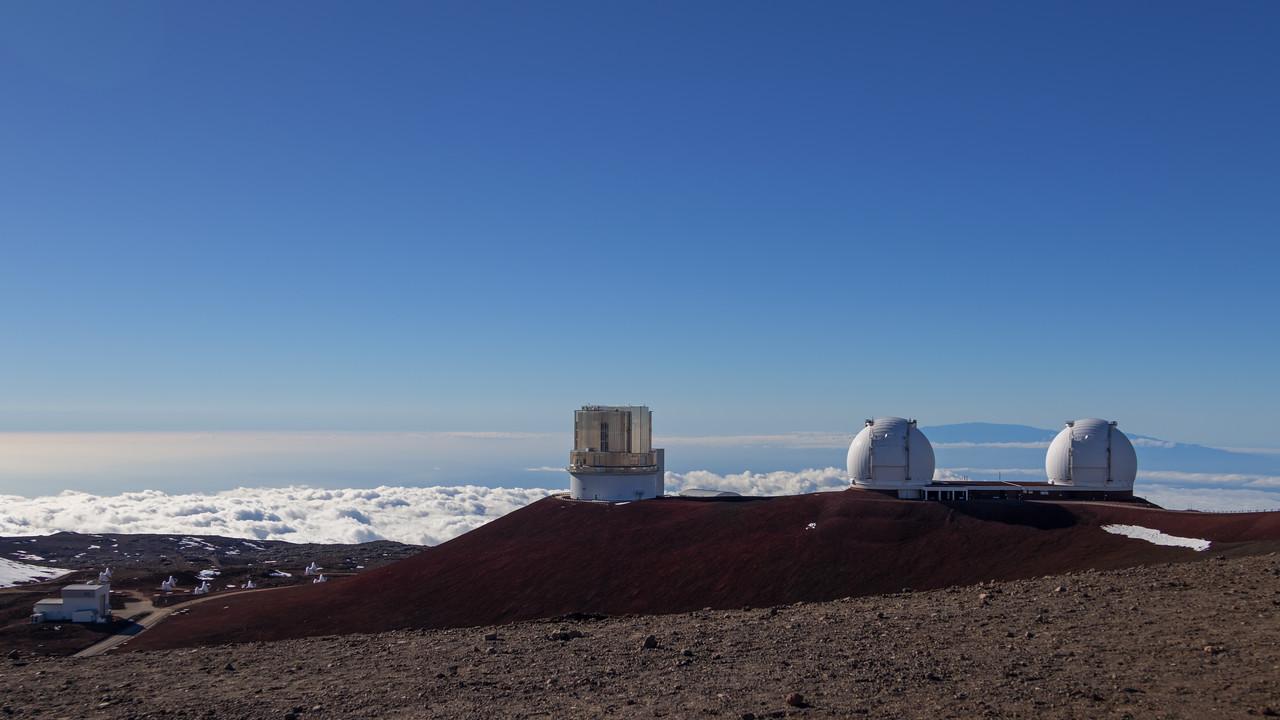 Keck I/II and Subaru telescopes at the summit of Mauna Kea, w/Haleakala in the background.