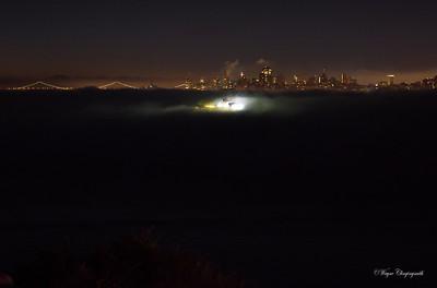 San Francisco at 6am 10/6/2012 - Fleet week Merchant ship lit up in the fog