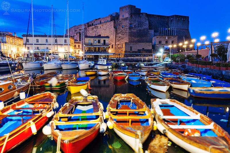 Colorful boats and Castel dell'Ovo in Naples