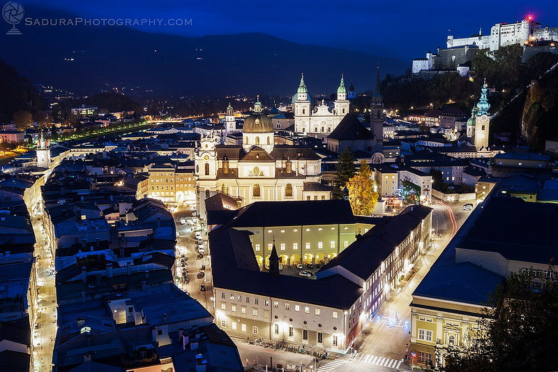 Sankt Michael Church and Salzburg Cathedral at evening